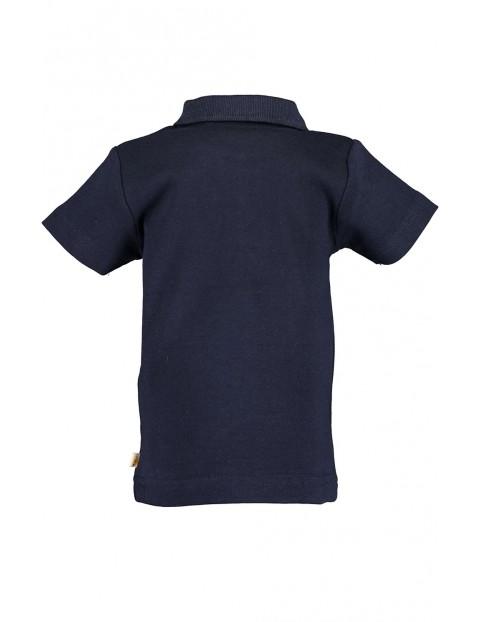 Koszulka niemowlęca granatowa dla chłopca z palmą