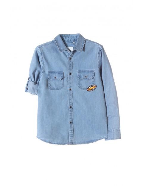 Koszula chłopięca niebieska- jeansowa z naszywkami