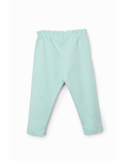 Spodnie dziewczęce sportowe niebieskie z ozdobnymi nadrukami