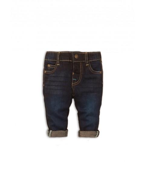 Granatowe jeansowe spodnie niemowlęce z kieszeniami