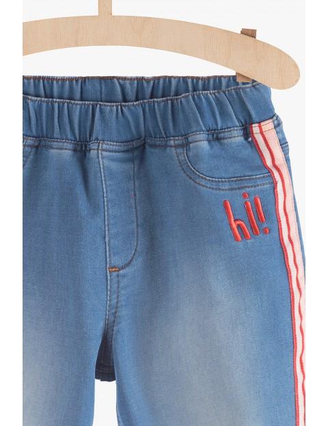 Spodnie jeansowe dziewczęce z lampasami