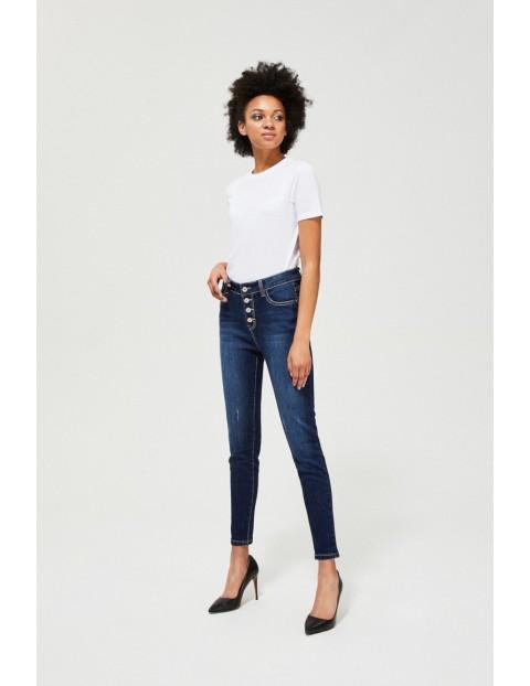 Granatowe jeansy damskie na guziki