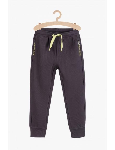 Spodnie dresowe z zasuwanymi kieszeniami- szare