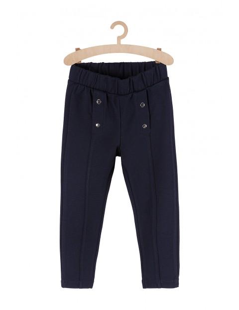 Granatowe spodnie dla dziewczynki-jegginsy z ozdobnymi guzikami