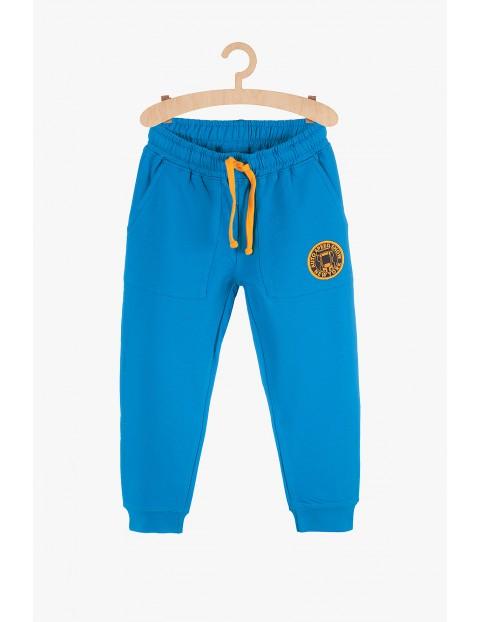 Dresowe spodnie chłopięce- niebieskie