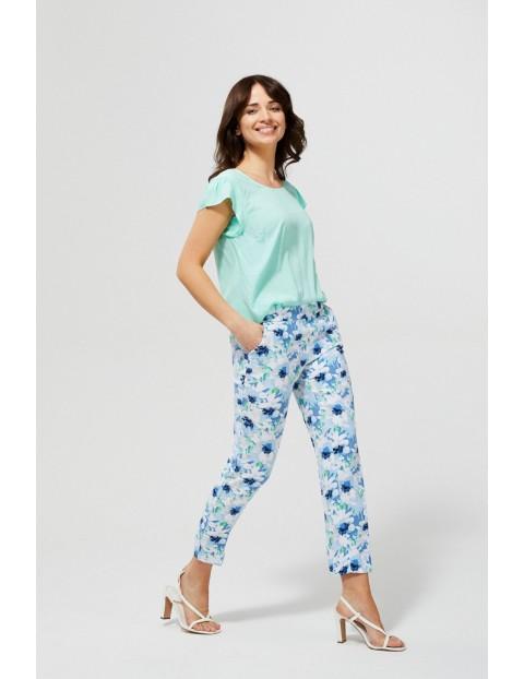 Spodnie damskie typu cygaretki w kwiaty