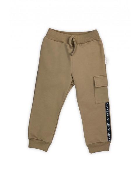 Spodnie dresowe chłopięce  - beżowe