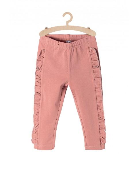 Spodnie dresowe dziewczęce z falbanką na nogawkach