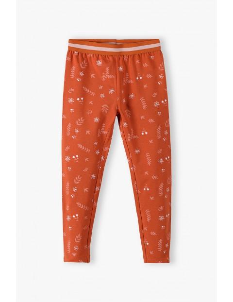 Pomarańczowe legginsy dziewczęce w liście