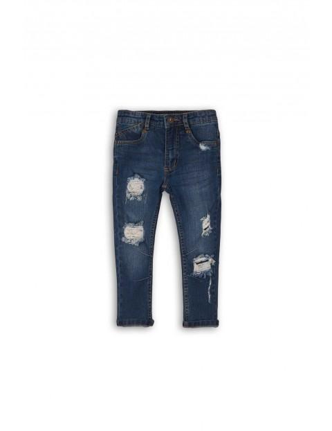 Spodnie chłopięce jeansowe z dziurami