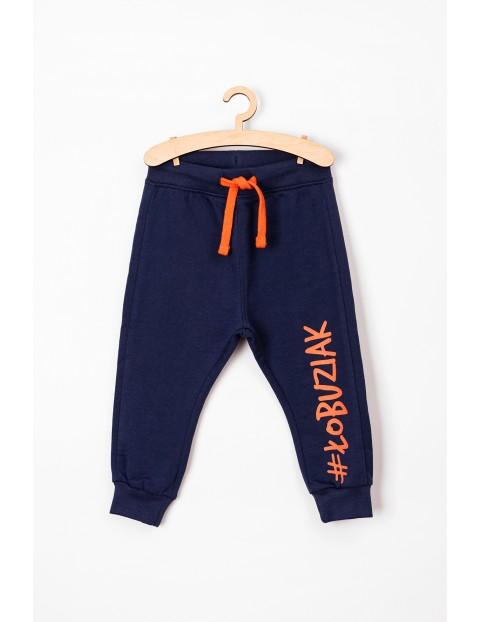 Spodnie niemowlęce dresowe granatowe #Łobuziak