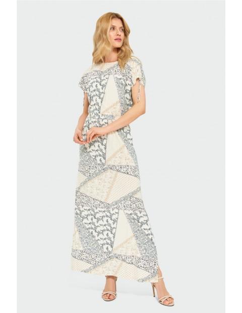 Duga wzorzysta sukienka damska w odciebiach beżu