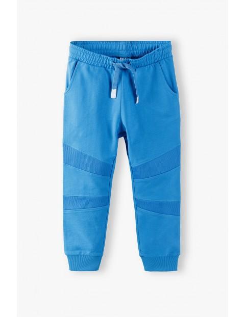 Spodnie dresowe chłopięce w kolorze niebieskim