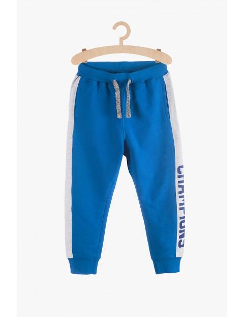 Spodnie dresowe chłopięce niebieskie-Champions