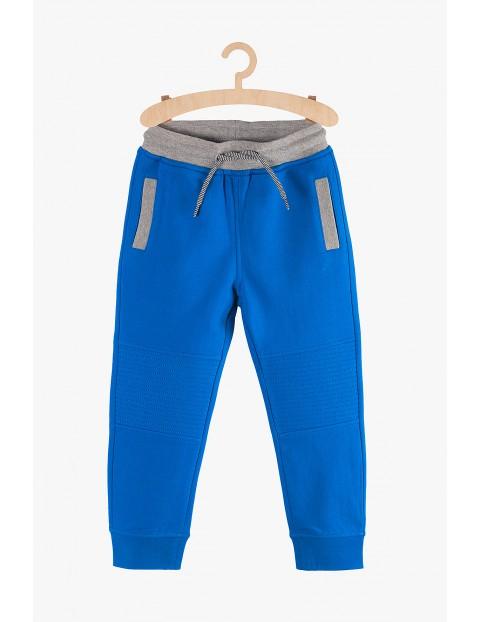 Spodnie chłopięce dresowe- niebieskie z kieszeniami