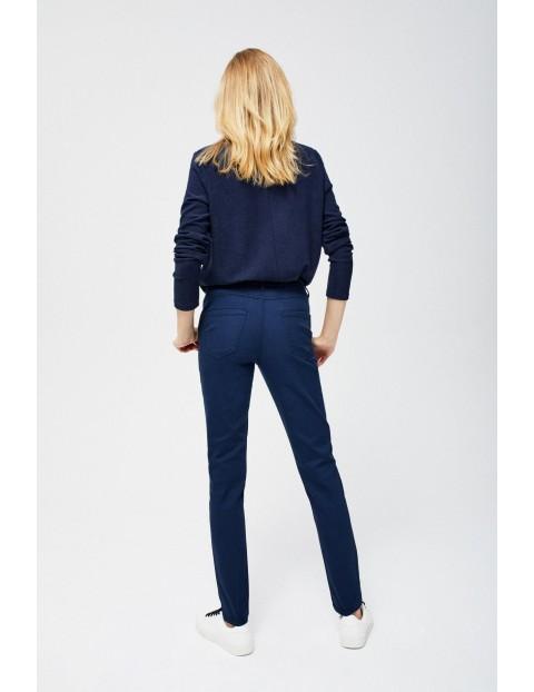 Granatowe spodnie z dżetami