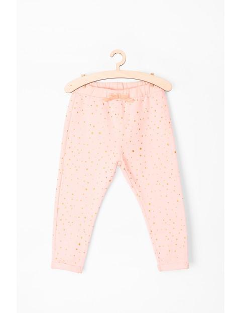 Spodnie niemowlęce dresowe- różowe w złote kropki