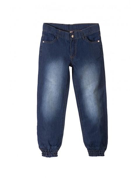 Spodnie dziewczęce jeansowe ze ściągaczami w nogawkach