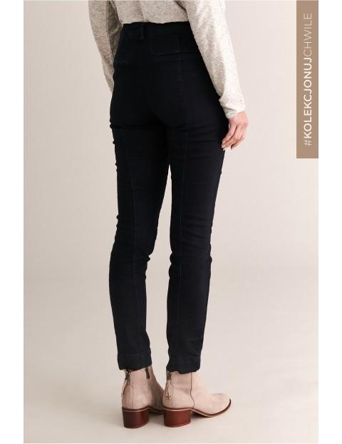 Spodnie damskie z ozdobnymi suwakami - czarne
