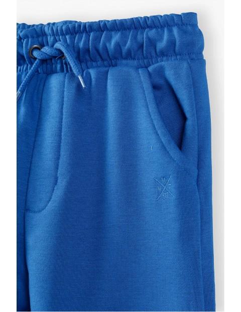 Spodnie dresowe niemowlęce niebieskie