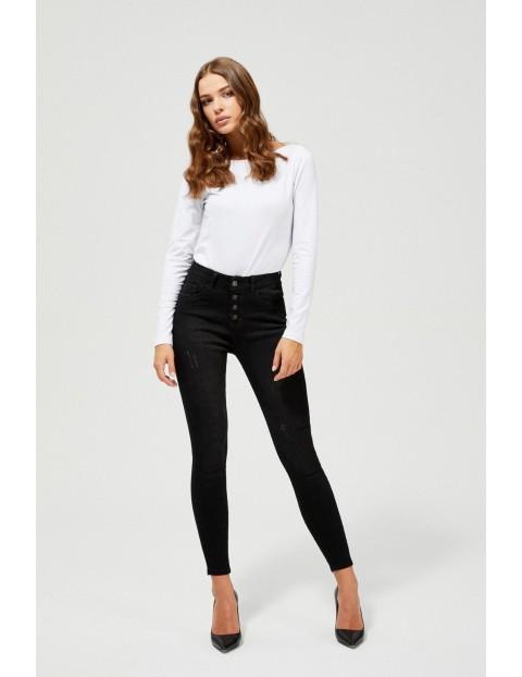 Czarne jeansy damskie rurki