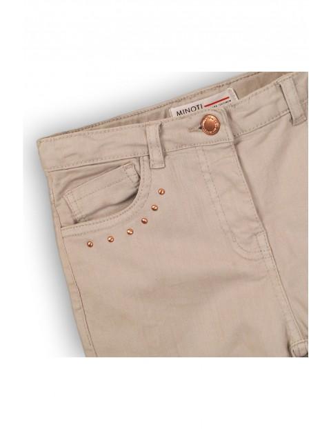 Spodnie dziewczęce beżowe z suwakami przy kieszeniach
