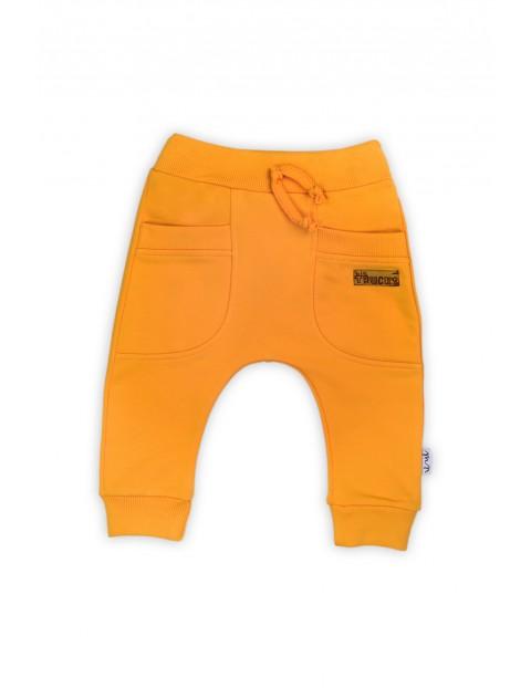 Spodnie dresowe chłopięce - żółte