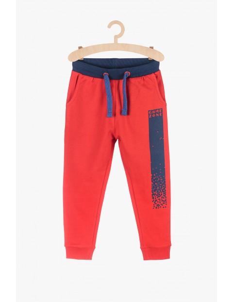 Spodnie dresowe chłopięce - czerwone Game Zone