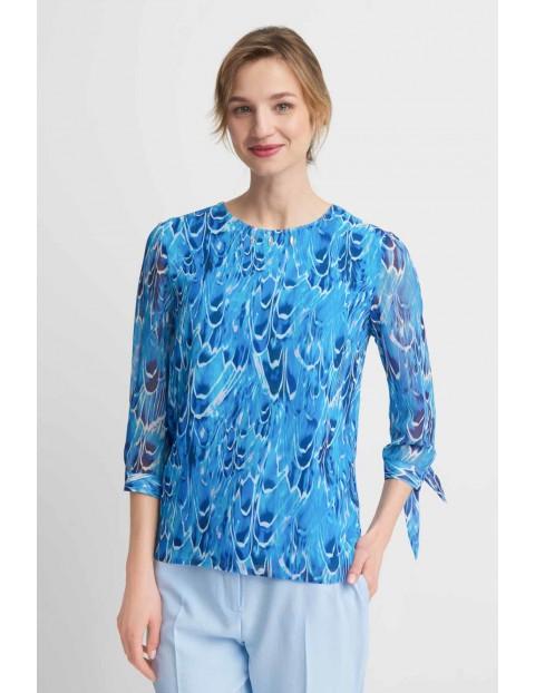 Niebieska bluzka z wiązanymi rękawami