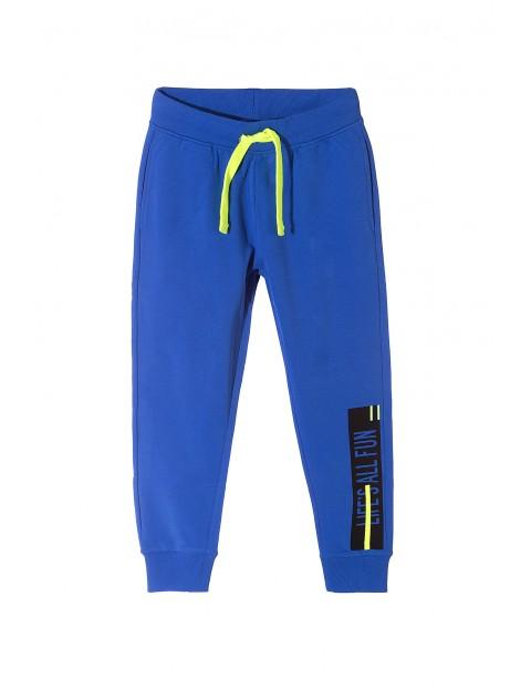 Spodnie dresowe chłopięce- niebieskie z kieszeniami