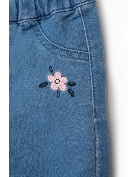 Jegginsy dziewczęce z kwiatkiem - niebieskie