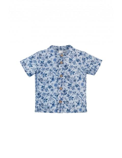 Bawełniana niebieska koszula chłopięca na krótki rękaw w kwiatki