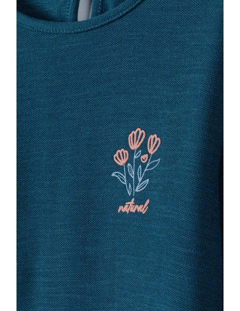 Bawełniana granatowa bluzka  dziewczęca z kwiatkiem