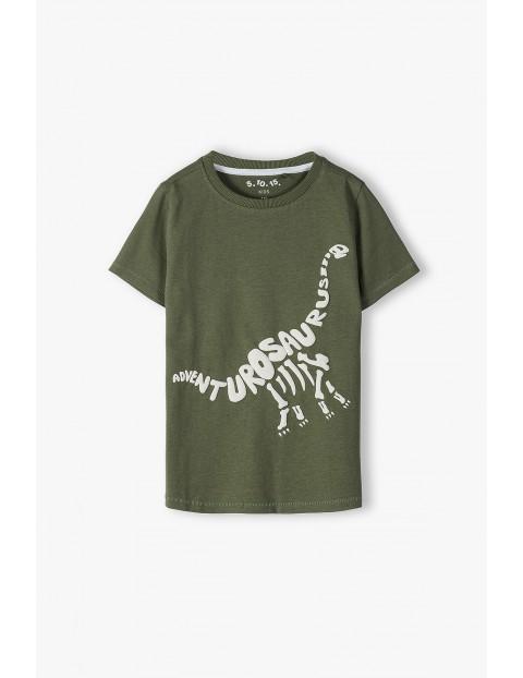 Bawełniany t-shirt chłopięcy w kolorze ciemnej zieleni z Dinozaurem