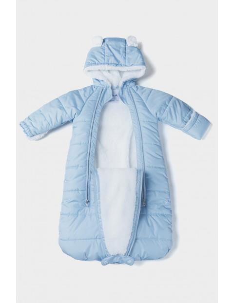 Kombinezon niemowlęcy z misiem w kolorze niebieskim