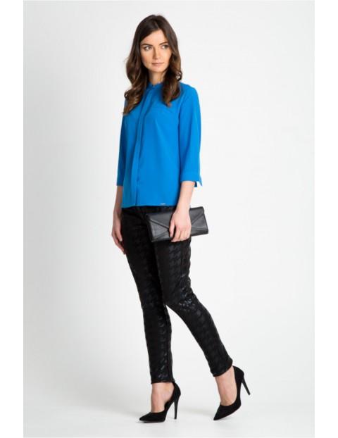 Wysokiej jakości niebieska bluzka o koszulowym kroju