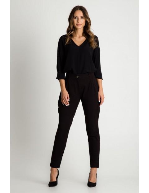 Zwężane spodnie z kieszeniami- czarne