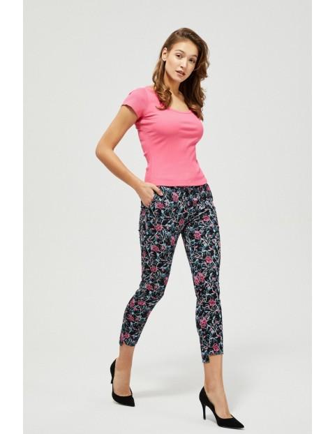 Spodnie cygaretki w kolorowe kwiaty