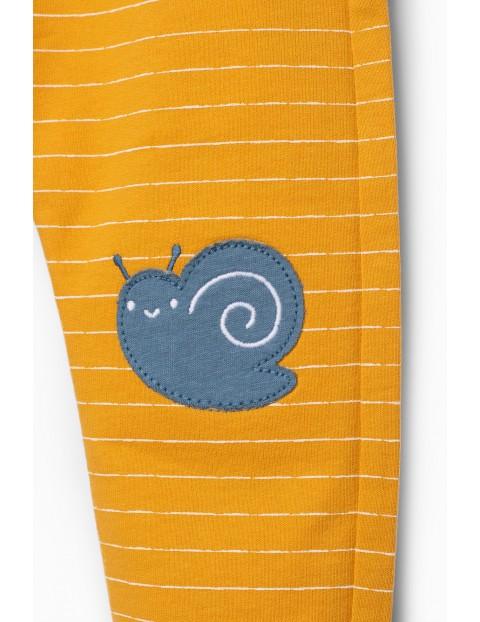 Żółte spodnie dresowe dla niemowlaka - ozdobne łaty