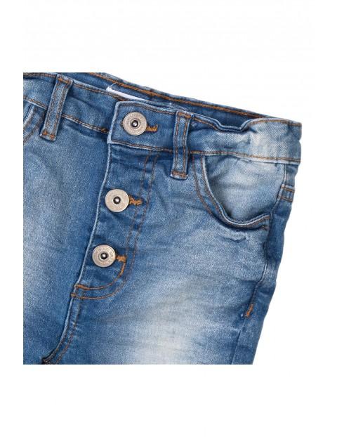 Spodnie dziewczęce jeansowe niebieskie z przebarwieniami