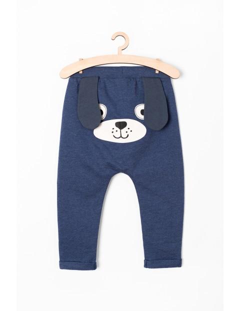 Spodnie dresowe niemowlęce z pieskiem - granatowe