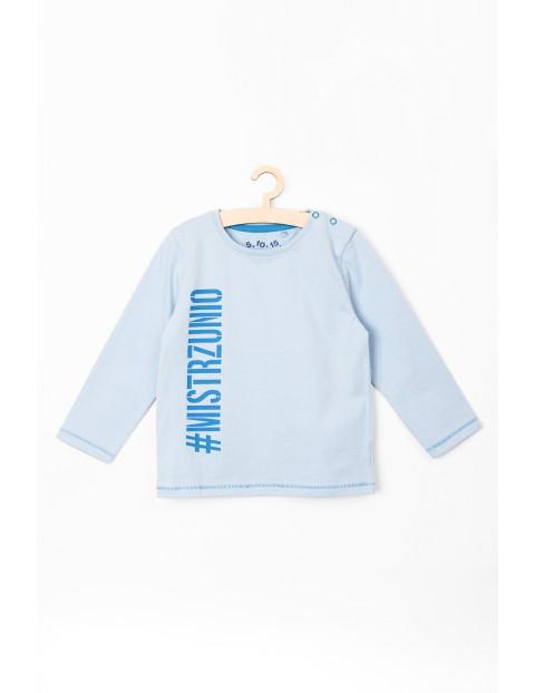 Bluzka niemowlęca błękitna z napisem #Mistrzunio