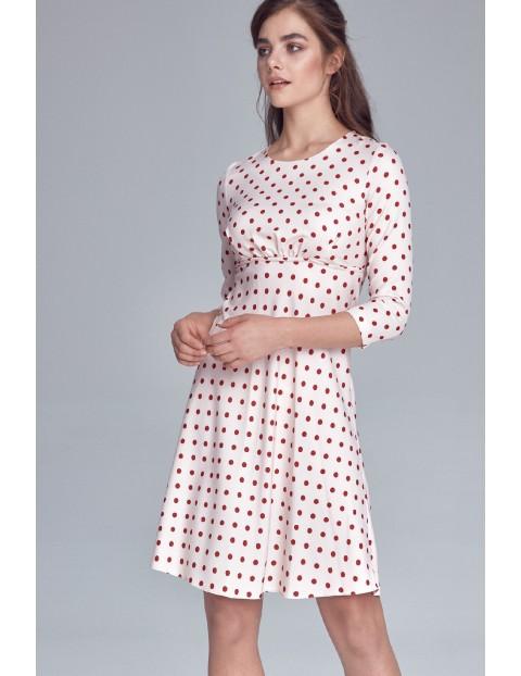 Jasnoróżowa sukienka damska w grochy