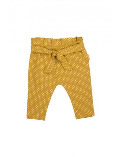 Musztardowe spodnie dziewczęce w kremowe kropeczki z wiązaniem