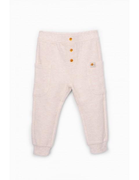Spodnie dresowe niemowlęce prążkowane z kieszeniami