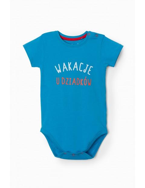 Niebieskie body niemowlęce z napisem- Wakacje u dziadków