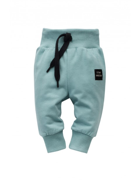 Spodnie niemowlęce bawełniane - niebieskie STAY GREEN