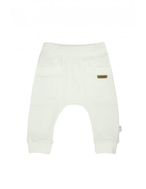 Kremowe spodnie dresowe dla dziewczynki typu baggy