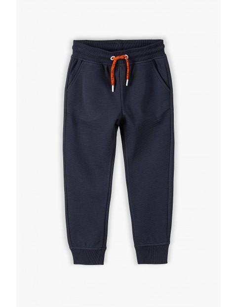 Bawełniane spodnie dresowe chłopięce -granatowe