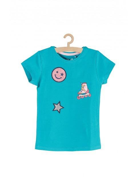 Koszulka dziewczęca z brokatowymi naszywkami i nadrukami
